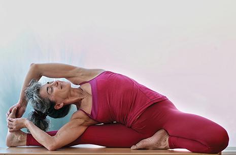 Maria Parivrtta Janu Sirsasana in yoga pose